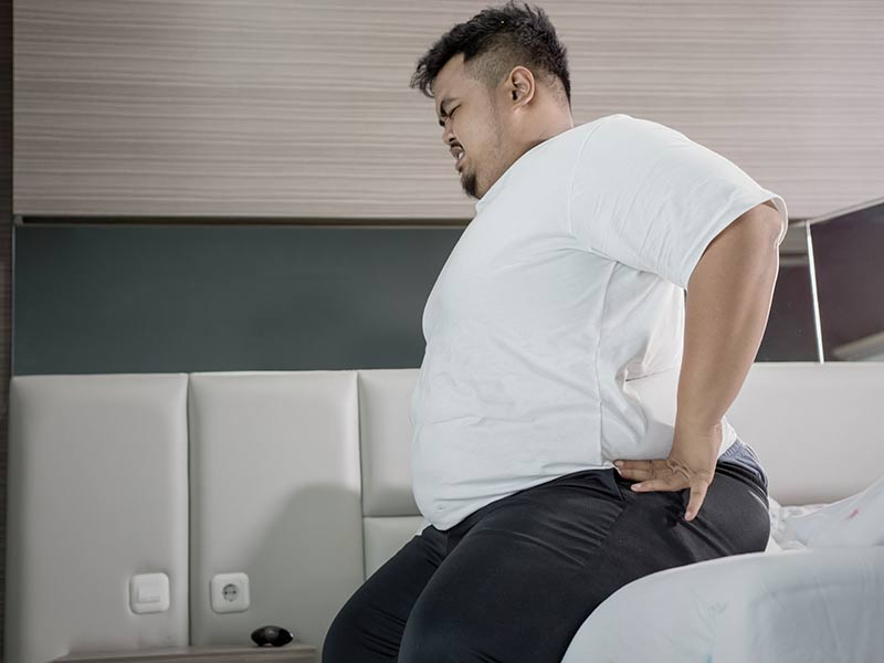 Man overweight with back pain