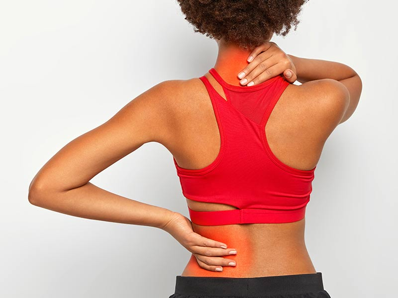 woman with thoracic spinal stenosis symptoms