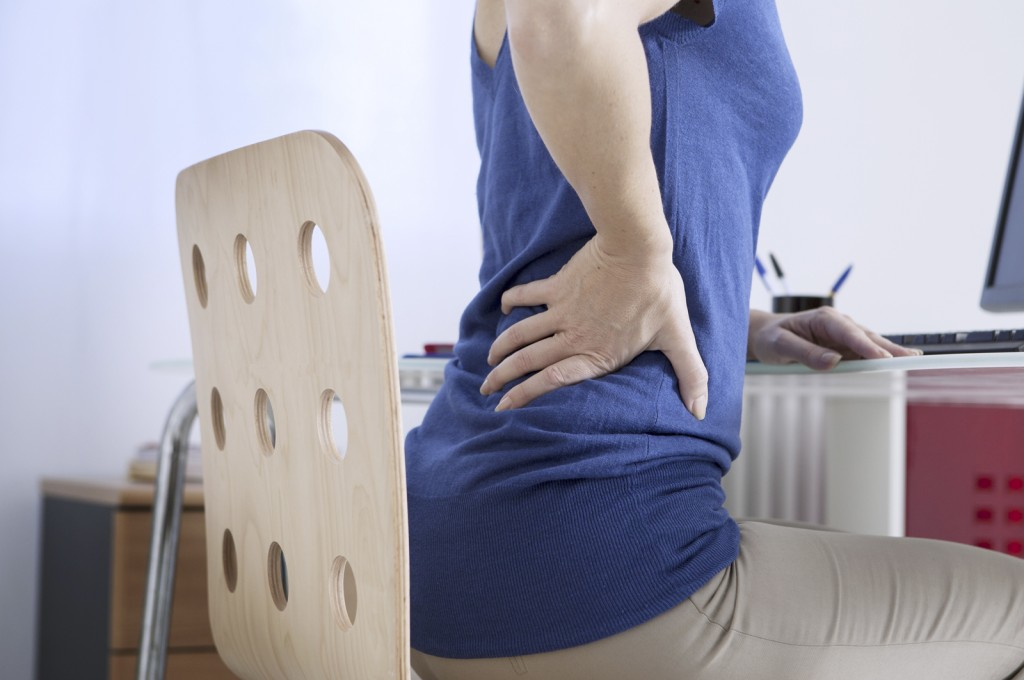 woman with lower back pain when sitting