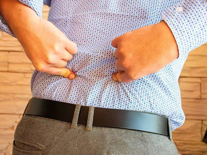 man points to lower back pain