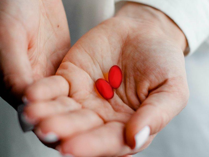Ibuprofen in woman's hand