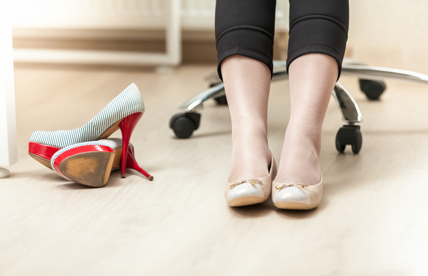 woman swapping high heels for flats