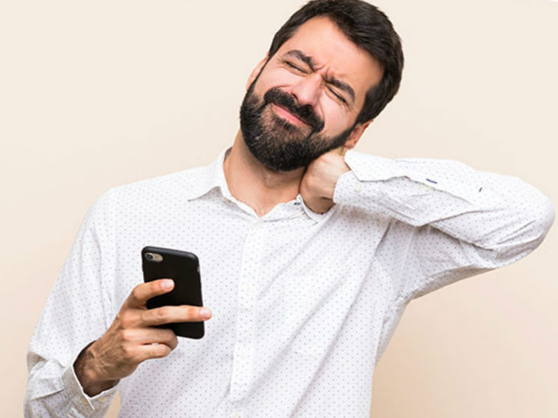 man on cellphone with text neck pain