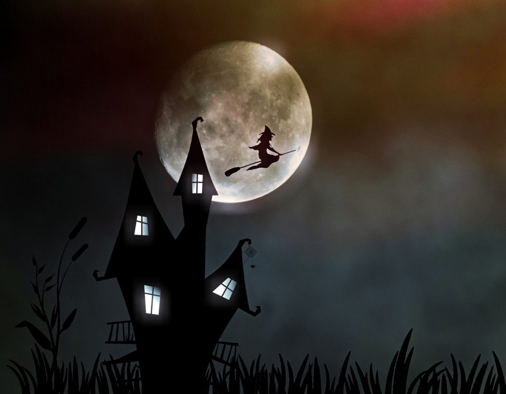 witch flying over full moon